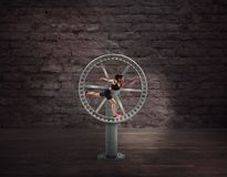 Athletic woman runs in a looping wheel. concept of sport routine royalty free stock photography