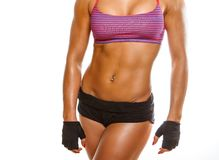 Athletic woman`s stomach. royalty free stock image