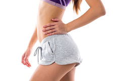 Athletic woman showing her buttocks Royalty Free Stock Images