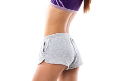 Athletic woman showing her buttocks Stock Images