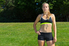 Athletic woman in a sports bra and shorts Royalty Free Stock Image