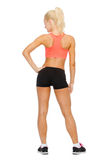 Athletic woman in sportswear from the back Stock Photos