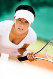 Athletic woman in sportswear playing tennis Royalty Free Stock Image
