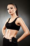 Athletic woman in sportswear standing akimbo Stock Images