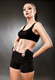 Athletic woman in sportswear standing akimbo Stock Photography