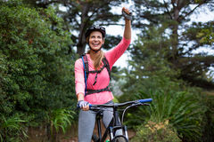 Athletic woman standing with mountain bike Stock Photos
