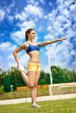 Athletic woman starching Stock Photography