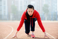 Athletic woman in start position on Royalty Free Stock Images