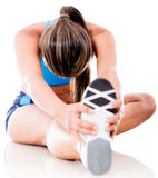 Athletic woman stretching Royalty Free Stock Photo