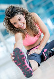 Athletic woman stretching Royalty Free Stock Images
