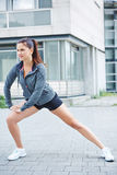 Athletic woman stretching before running Stock Image