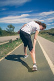 Athletic woman suffering pain in leg calf by cramp Royalty Free Stock Photography