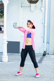 Athletic woman swinging kettlebell stock photography