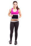 Athletic woman with a tablet Stock Photos
