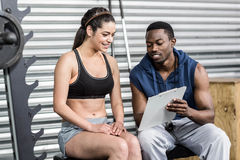 Athletic woman and trainer smiling to camera. Athletic women and trainer smiling to camera at crossfit gym Royalty Free Stock Photo