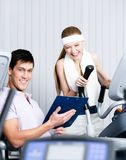 Athletic woman training in gym Stock Image