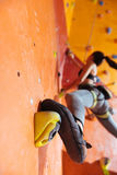 Athletic woman training hard in climbing gym Stock Photos