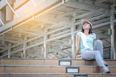 Athletic woman after training outdoors in the morning Stock Photo