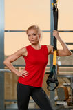 Athletic woman trx Stock Photography