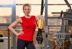 Athletic woman trx Stock Images
