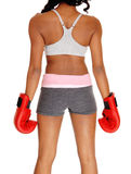 Athletic woman wearing boxing gloves. Royalty Free Stock Photos