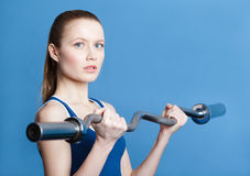 Athletic woman with weight Stock Photography