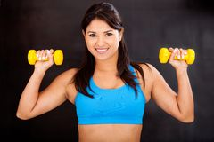 Athletic woman with weights Royalty Free Stock Photos