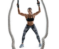 Athletic woman working with heavy ropes. Royalty Free Stock Photo