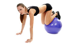 Athletic woman working out her abs and legs Royalty Free Stock Photography