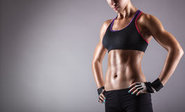 Athletic woman. Young athletic woman on a gray background Royalty Free Stock Photo