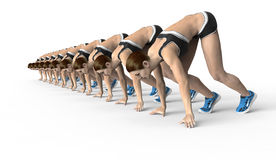 Athletic women crouched starting position ready to start running Stock Photo