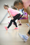 Athletic women doing stretching exercises Stock Photo