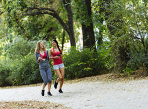 Athletic women jogging in nature Stock Photo