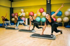 Athletic women on step aerobic workout indoor Stock Photography