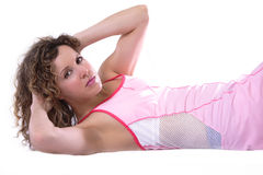 Athletic workout situps. Fit brunette girl working out on abs getting in shape stock photo