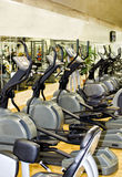 Athletic xtrainer machines. In the fitness club Stock Photo