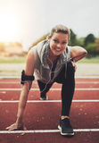 Athletic young blonde woman looking at camera while stretching Stock Image
