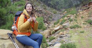 Athletic young female backpacker stock video