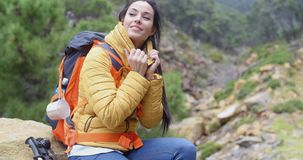 Athletic young female backpacker stock footage