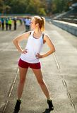Athletic young girl doing exercises healthy lifestyle outdoor Royalty Free Stock Image