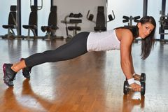 Athletic young lady doing workout in fitness studio Royalty Free Stock Images