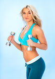 Athletic young lady doing workout Royalty Free Stock Photo