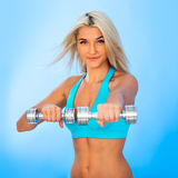 Athletic young lady doing workout Stock Photography