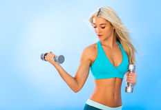 Athletic young lady doing workout with weights Stock Photography