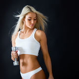 Athletic young lady doing workout Royalty Free Stock Photos