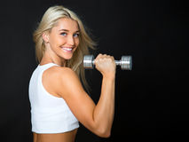 Athletic young lady doing workout with weights Stock Photo