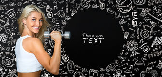 Athletic young lady doing workout with weights on black and draw Royalty Free Stock Images