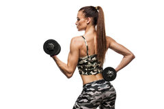 Athletic young lady doing workout with weights Royalty Free Stock Photography