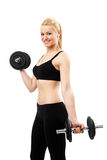Athletic young lady working out with weights Royalty Free Stock Images