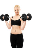 Athletic young lady working out with weights Royalty Free Stock Photos